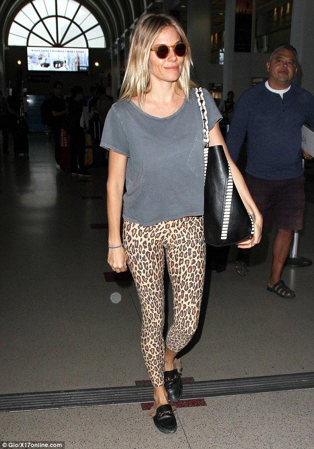 2cf409d639d92 Pretty in prints: Sienna Miller jetted into LAX in leopard-print leggings  and a grey T-shirt on Wednesday