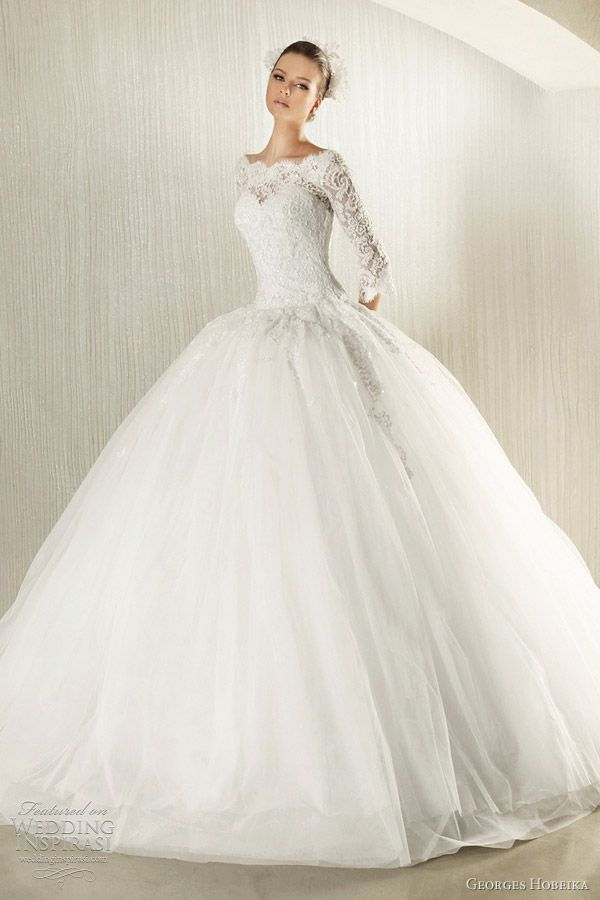 Princess-like ball gown with 3/4 sleeve lace top.