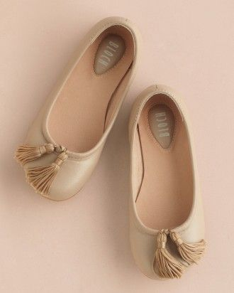 Tassels hand-sewn to ballet flats will give you a reason to twirl.
