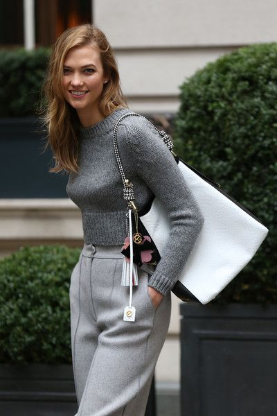 Karlie Kloss spotted during London Fashion Week with Kurt Geiger bag and trainers at Rosewood Hotel on February 21, 2016 in London, England.