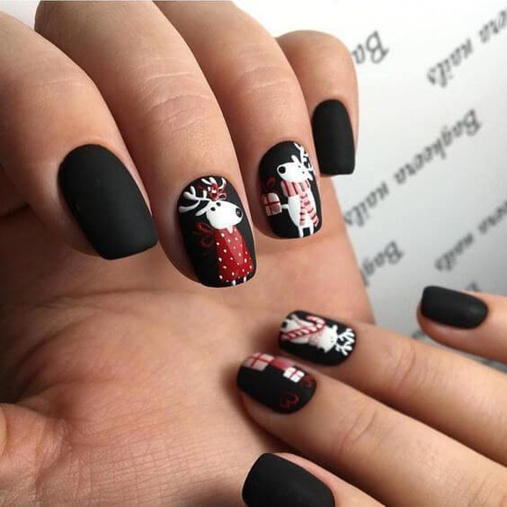 Cute nail design with a deer for Christmas. Black matt nail polish ...