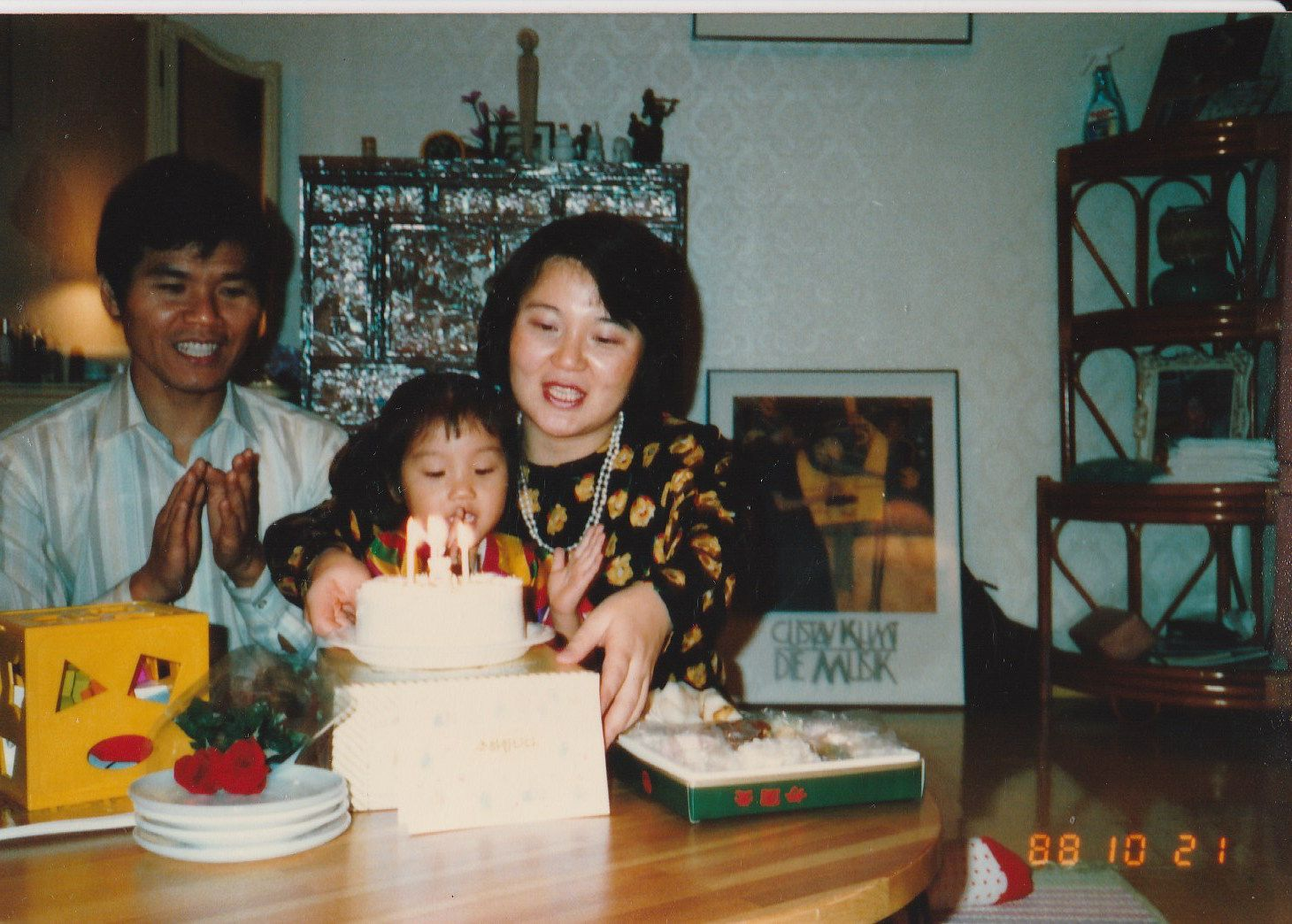 When I was young. With father and mother on my third