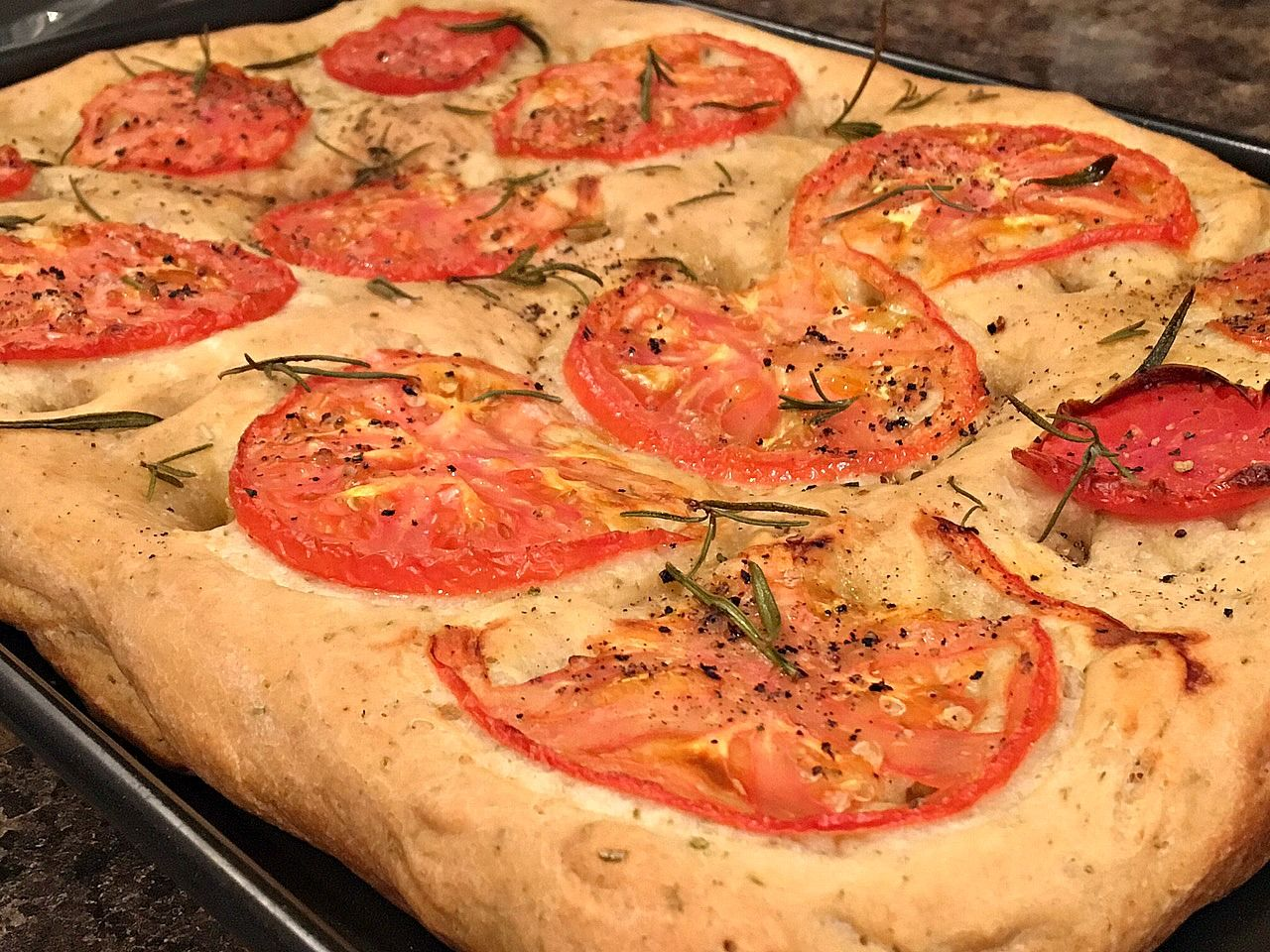 TOMATO ROSEMARY FOCACCIA - This tasty Italian flatbread is a snap to make. So for anyone who hasn't made bread before, you should give it a try! VIDEO https://www.youtube.com/watch?v=ZhSLnooSgeQ For ingredient amounts and much more, visit http://clubfoody.com/recipe/tomato-rosemary-focaccia/