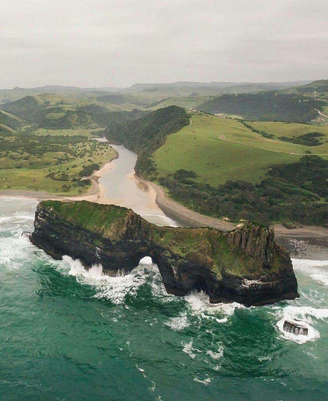 the hole in the wall is a rocky archway set just off the on hole in the wall rock formation eastern cape id=53159