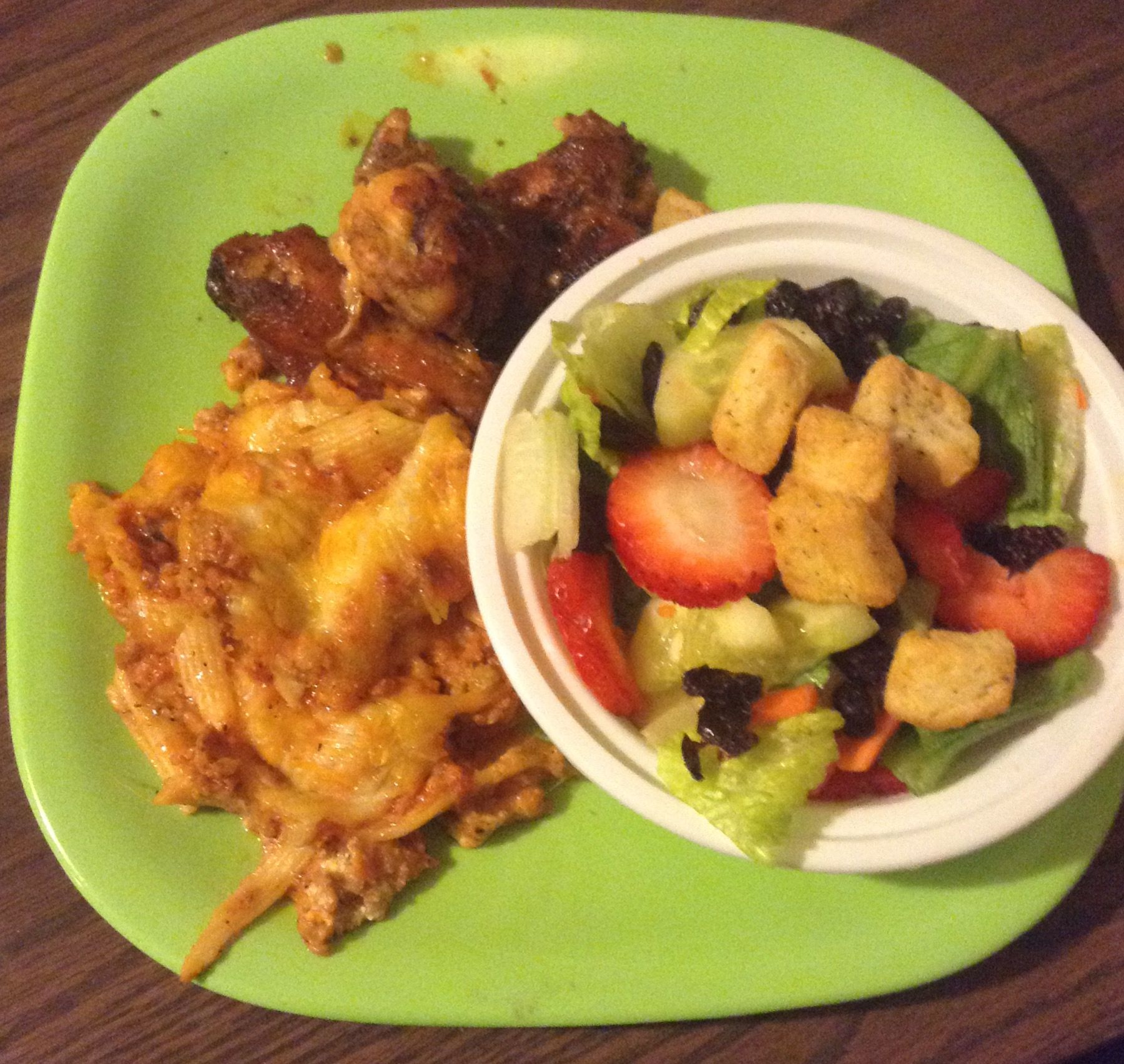 Blueberry & strawberry salad with baked zitiand sweet chili hit wings