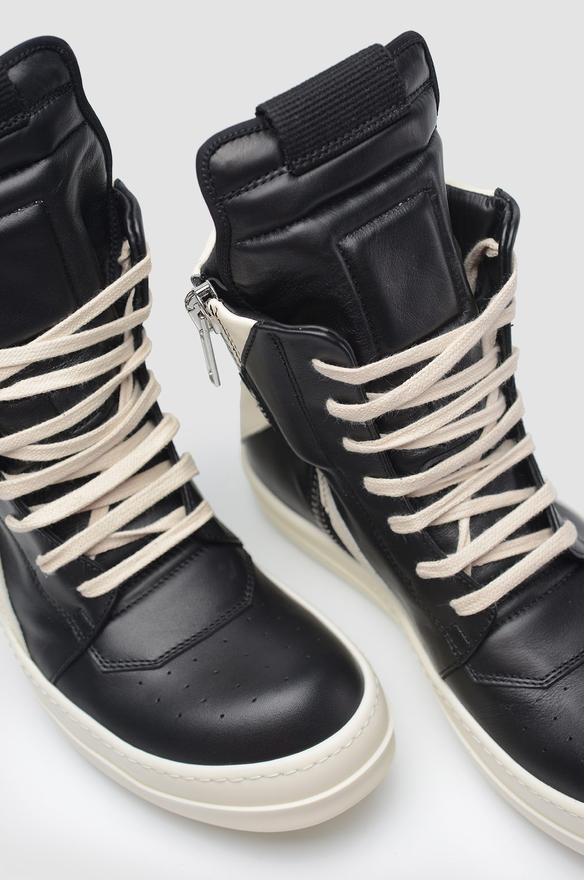bf118c18601546 Black lace up high top sneakers. Off-white sole and laces. Zipper closure.  Upper  100% Calf Leather Sole  100% Rubber Made in Italy