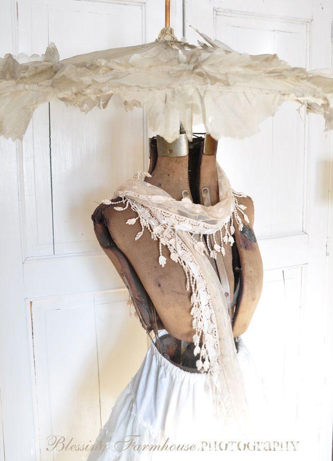 Dress form with vintage parasol