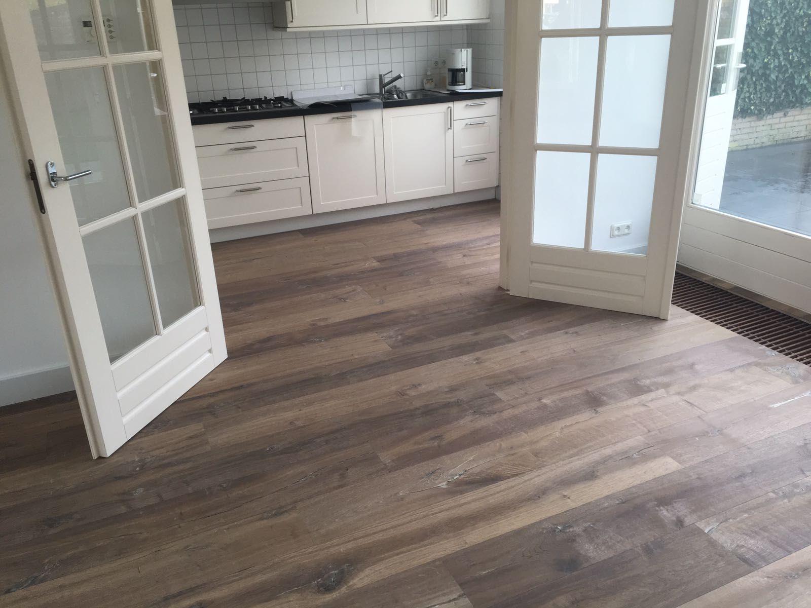 Houten vloer leggen legkosten houten vloer verlijmen per m