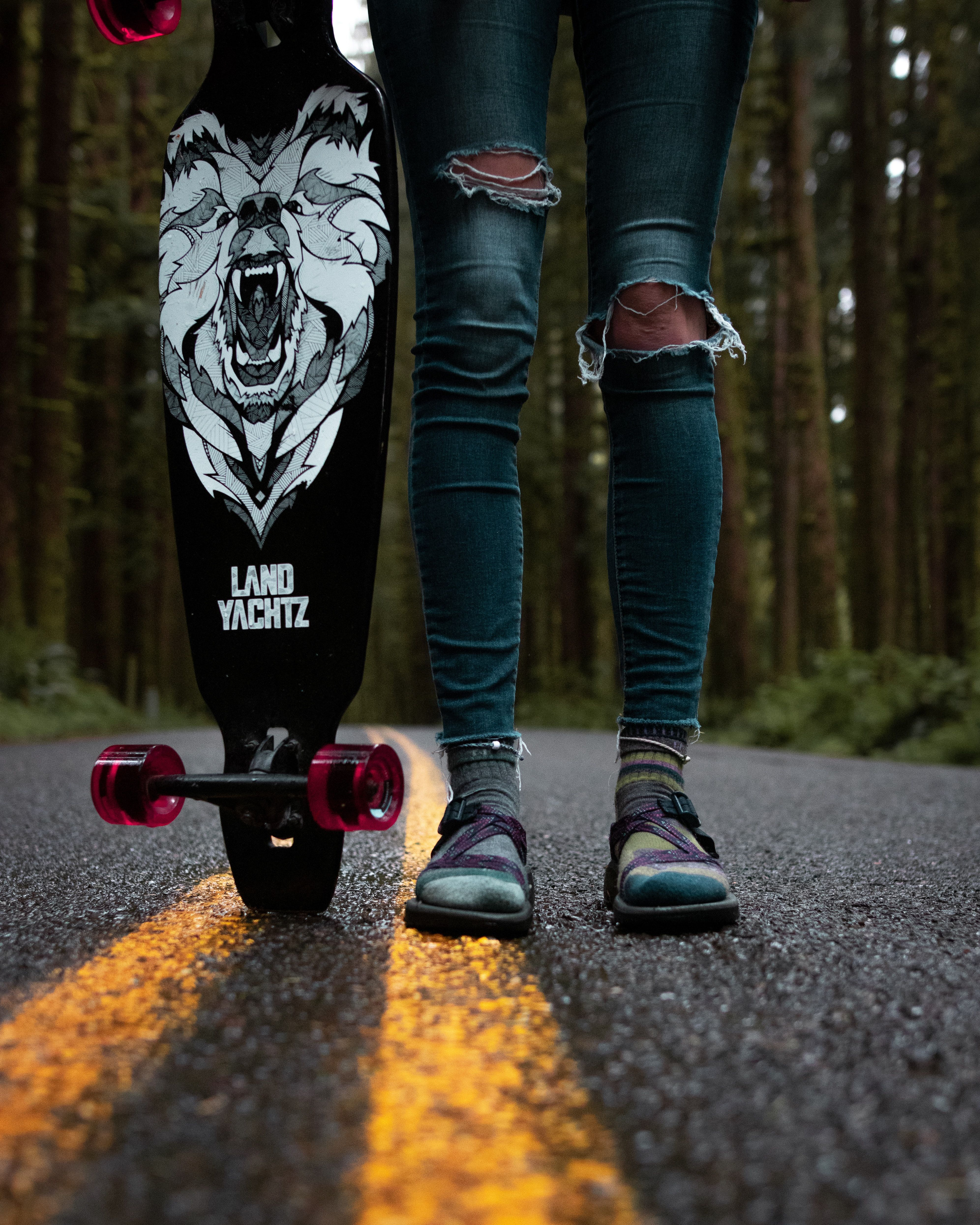 Apparel Clothing Pants Person Standing And Person Standing And Holding Black And White Skateboard Skateboard Skateboard Deck Art Skateboard Decks