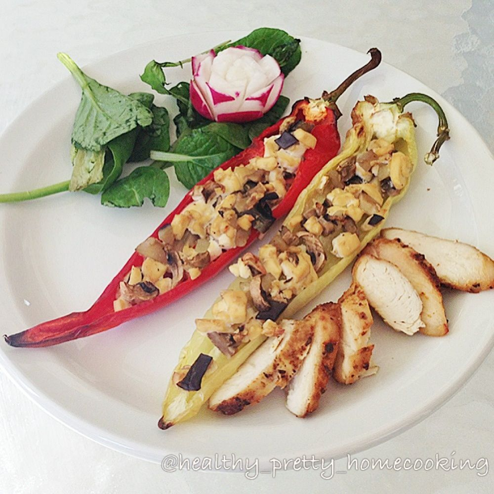 Stuffed banana-pepper with tofu, eggplant, mushroom, sided with Moroccan chicken tenderloin and radish rose spinach salad.