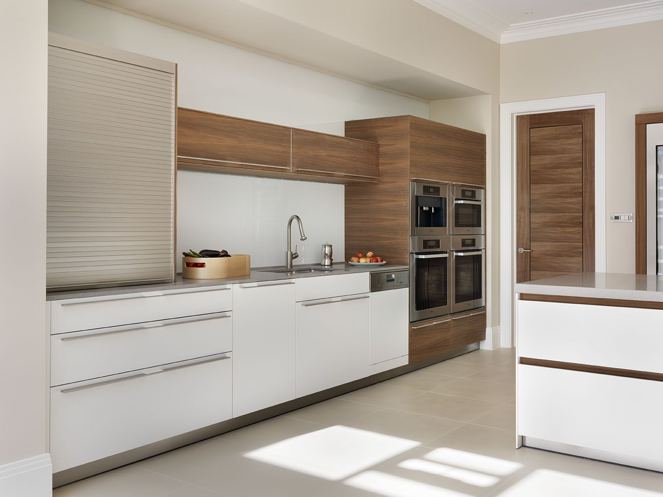 Kitchen Roller Doors hidden storage for those 'everyday' items is provided using the