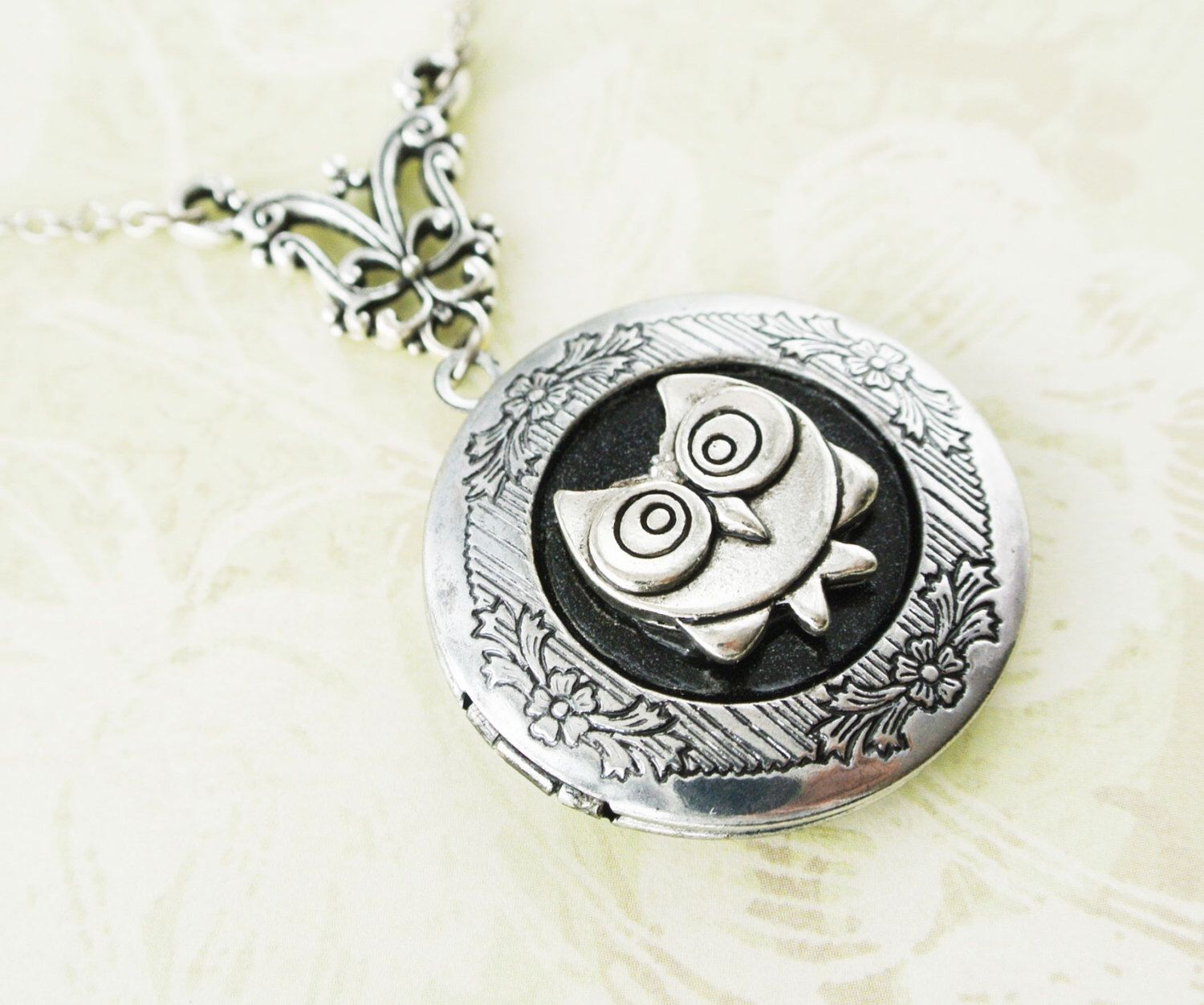 A personal favorite from my Etsy shop https://www.etsy.com/listing/210935184/owl-locket-necklace-antique-silver