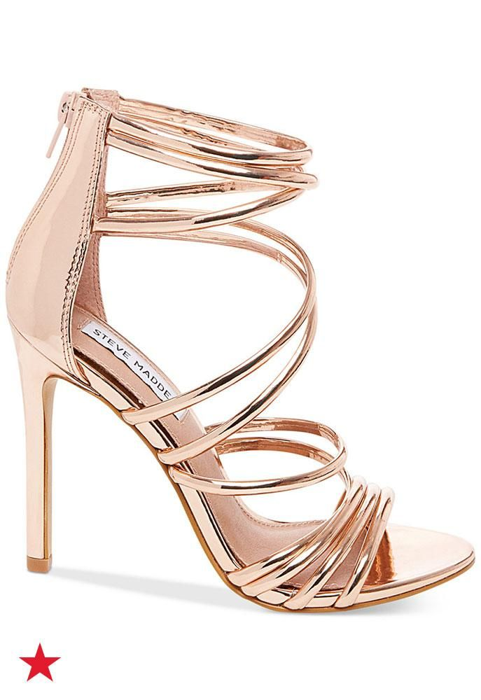 13953b577957 No night out look is complete without a pair of metallic strappy sandals  from Steve Madden. A stiletto heel and gorgeous rose gold color make these  a ...