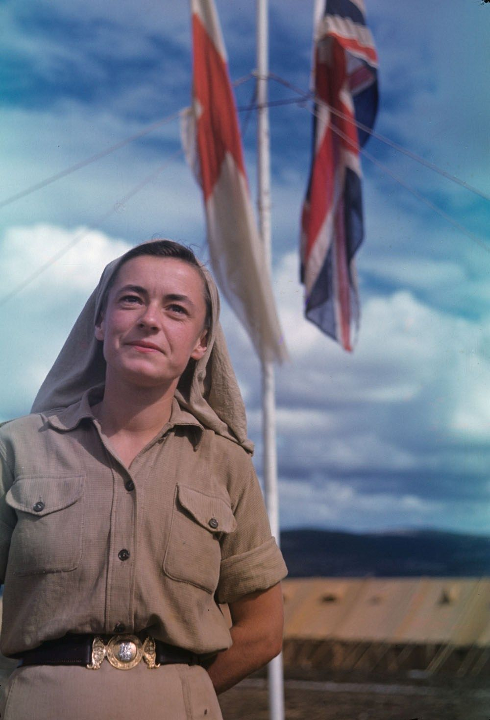 Canadian Army nurse Valerie Hoare poses outside field Hospital in North Africa, 1942.