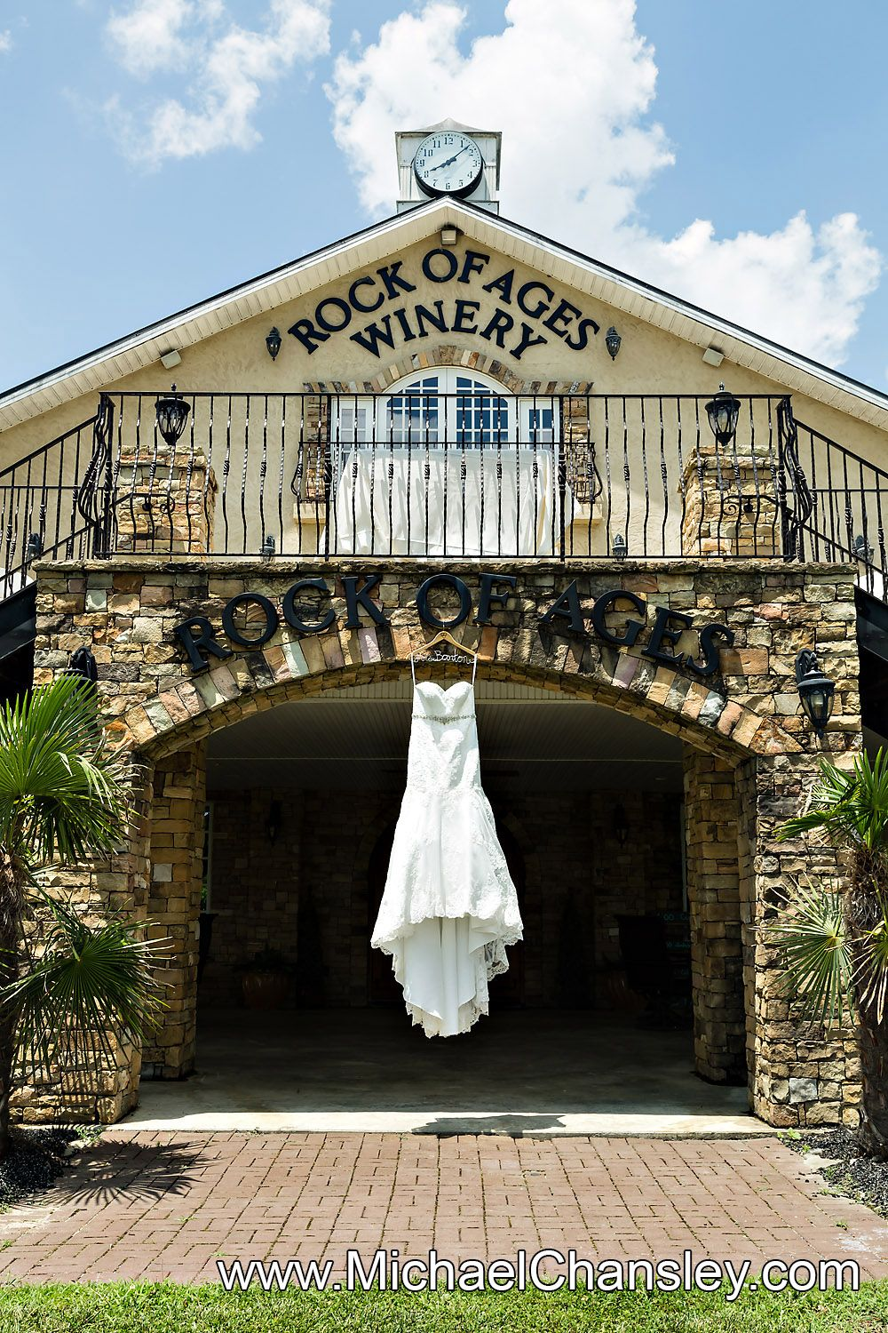Brides dress hangs on display for a portrait photo at rock of ages