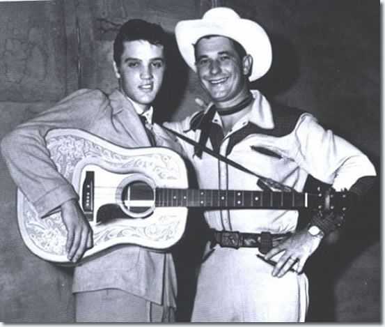 Elvis Presley and Texas Bill Strength at the Overton Park Shell , Memphis - I think this was the Aug 5th, 1955 concert. Elvis had his very cool Martin D-28 guitar with it's tooled leather custom cover on it -- his name was emblazoned on the tooling that is hidden under his arm