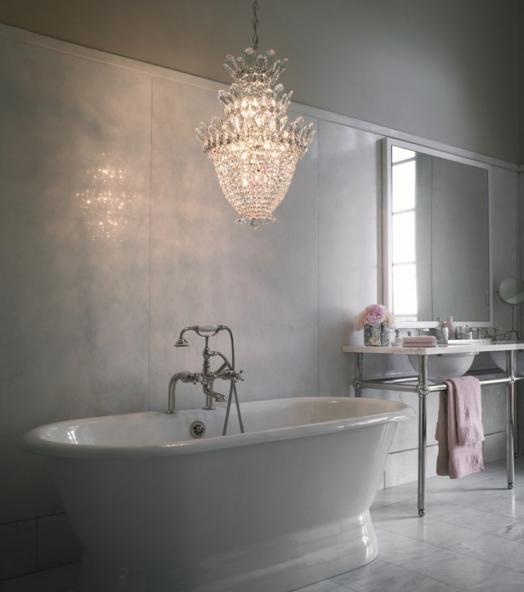 Bathroom with freestanding tub and crystal chandelier design