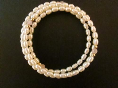 """This shimmering #pearl coil #bracelet has 107 rice-shaped #freshwaterPearls accented with #amethyst and #14kgold beads. Most of these bracelets have only 2 loops of pearls but this one has 3 loops on sterling silver """"memory"""" wire which holds the pearls in a beautiful coil that fits any wrist. A huge bargain at $19.99.  FREE SHIPPING"""