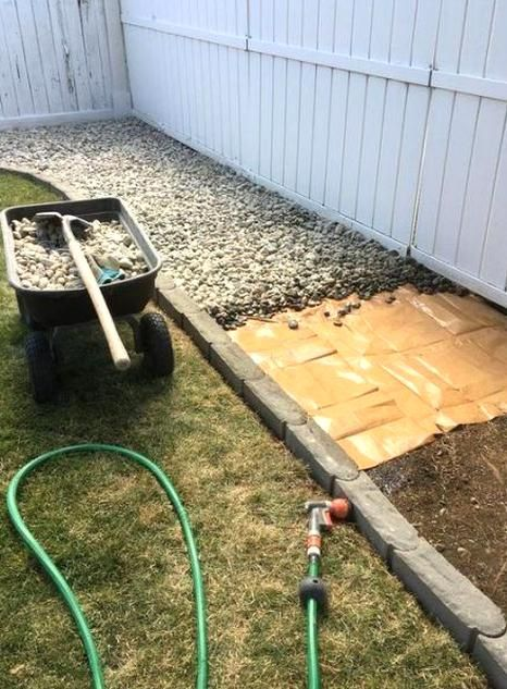 Low Cost Rock Bed Create A Beautiful Outdoor Living Space With These Inexpensive B In 2020 Backyard Landscaping Cheap Landscaping Ideas Beautiful Outdoor Living Spaces