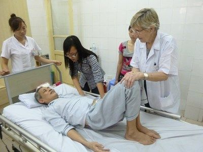 Volunteer Nurse Treats Elderly Patients in a Hospital in Vietnam