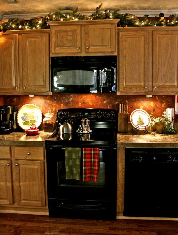 christmas garland on plant shelves or above kitchen cabinetsi could do both - Christmas Decorations For Kitchen Cabinets