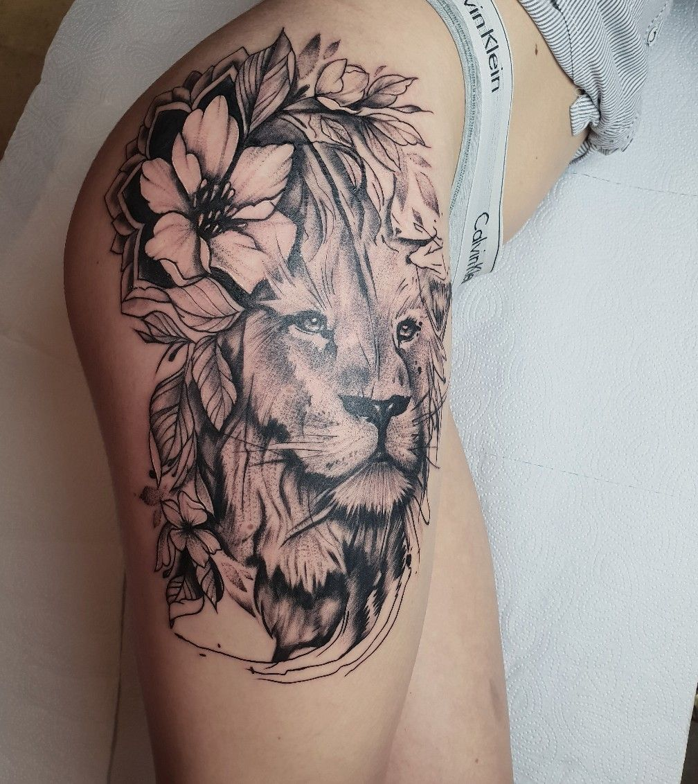 Photo of Flower tattoo on thigh dotwork by Igor Kiryuhin