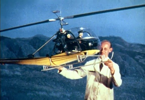 Pinewood's Bert Luxford, a member of John Stears special effects team with a miniature helicopter on the set of FROM RUSSIA WITH LOVE.