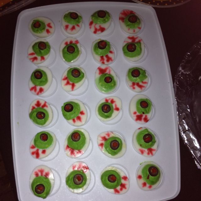 Deviled eggs with green food coloring black olive slice and red food coloring for veining do the red at the last minute