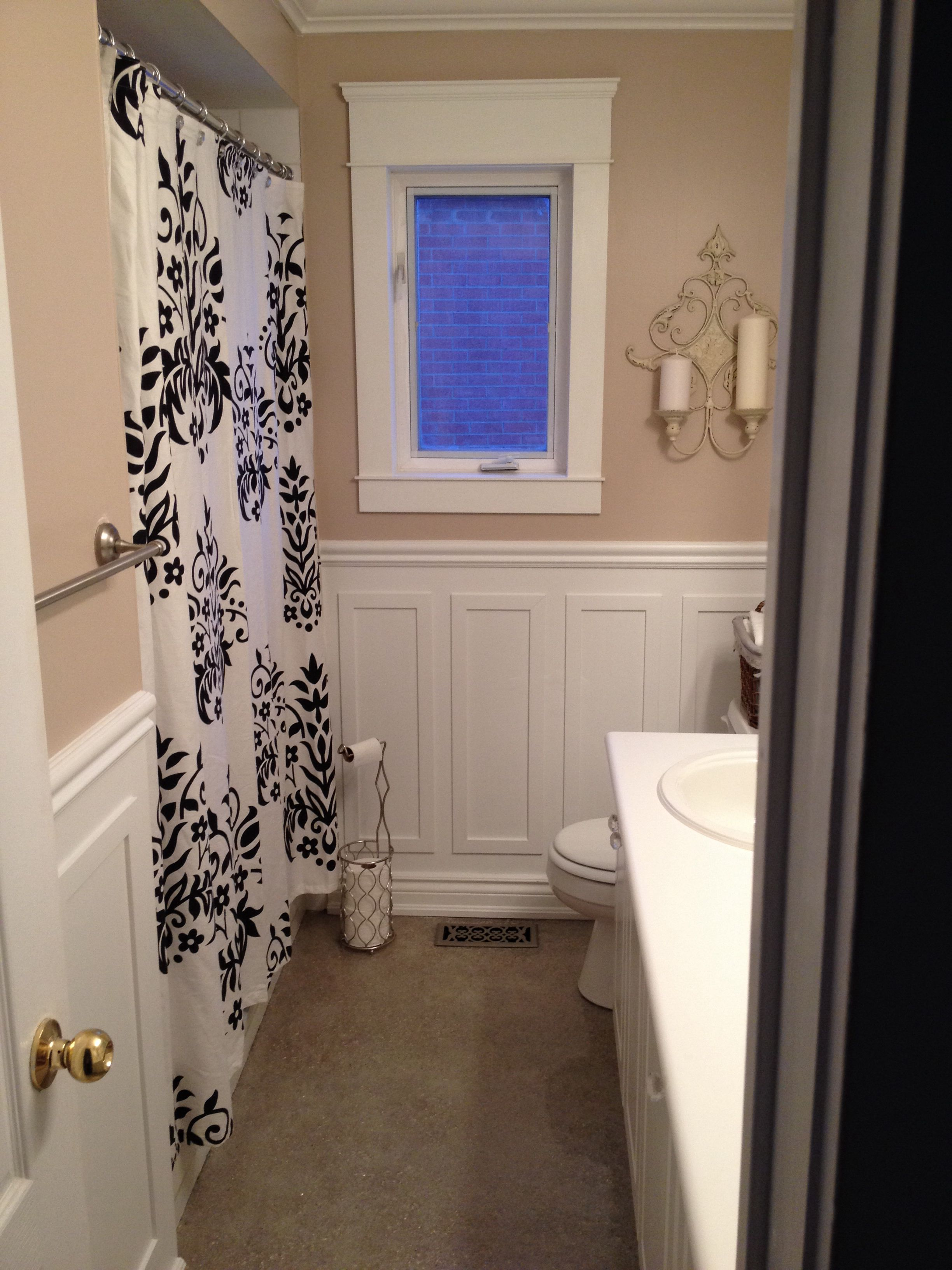 Terrazzo floors wainscoting and light taupe bathroom home