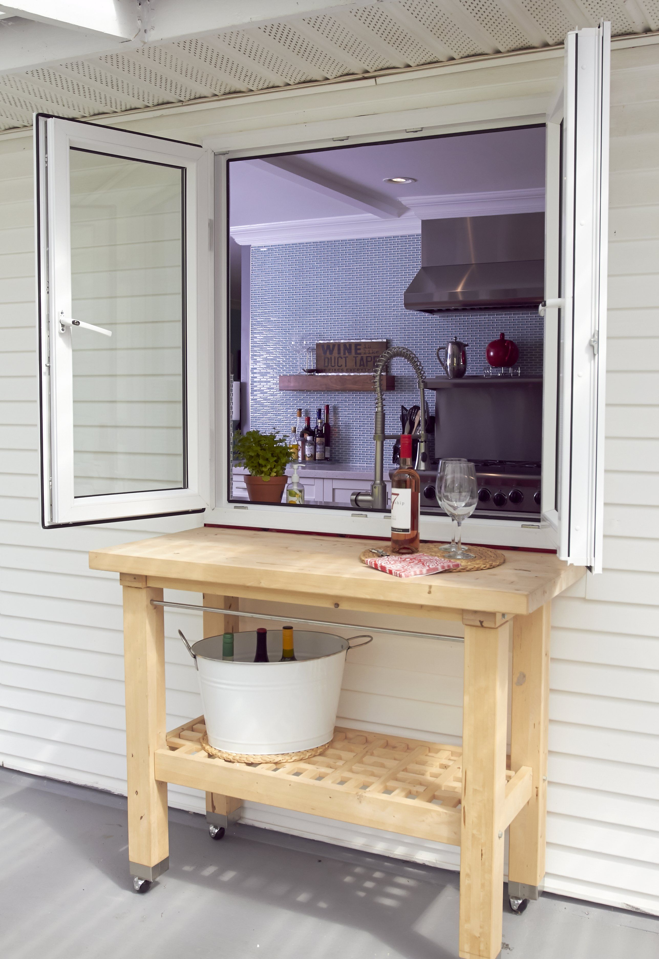 A little bit of wine + summer time=the best combo! Add in our Tilt and Turn patio pass-over window and you have the perfect solution for summer parties