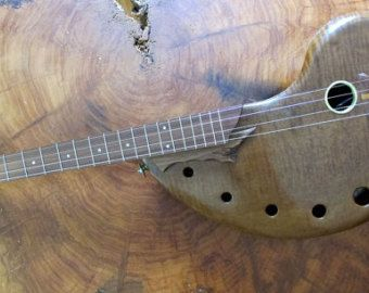 Handmade musical 4 string instrument.Unique, fretted.
