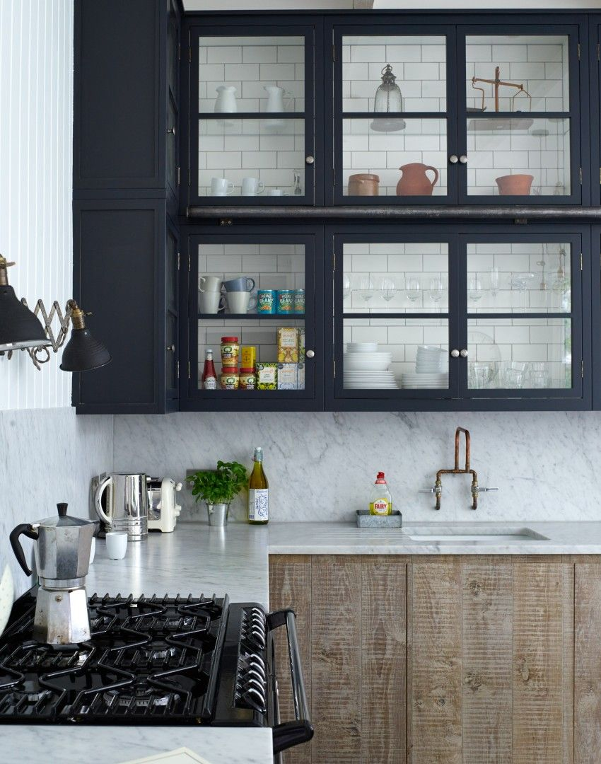 A stunning kitchen design on theroomedit this combination of the look is open backed cabinetry reclaimed and mounted on subway tile but obviously you could just back the inside with tile and reconfigure with glass dailygadgetfo Choice Image