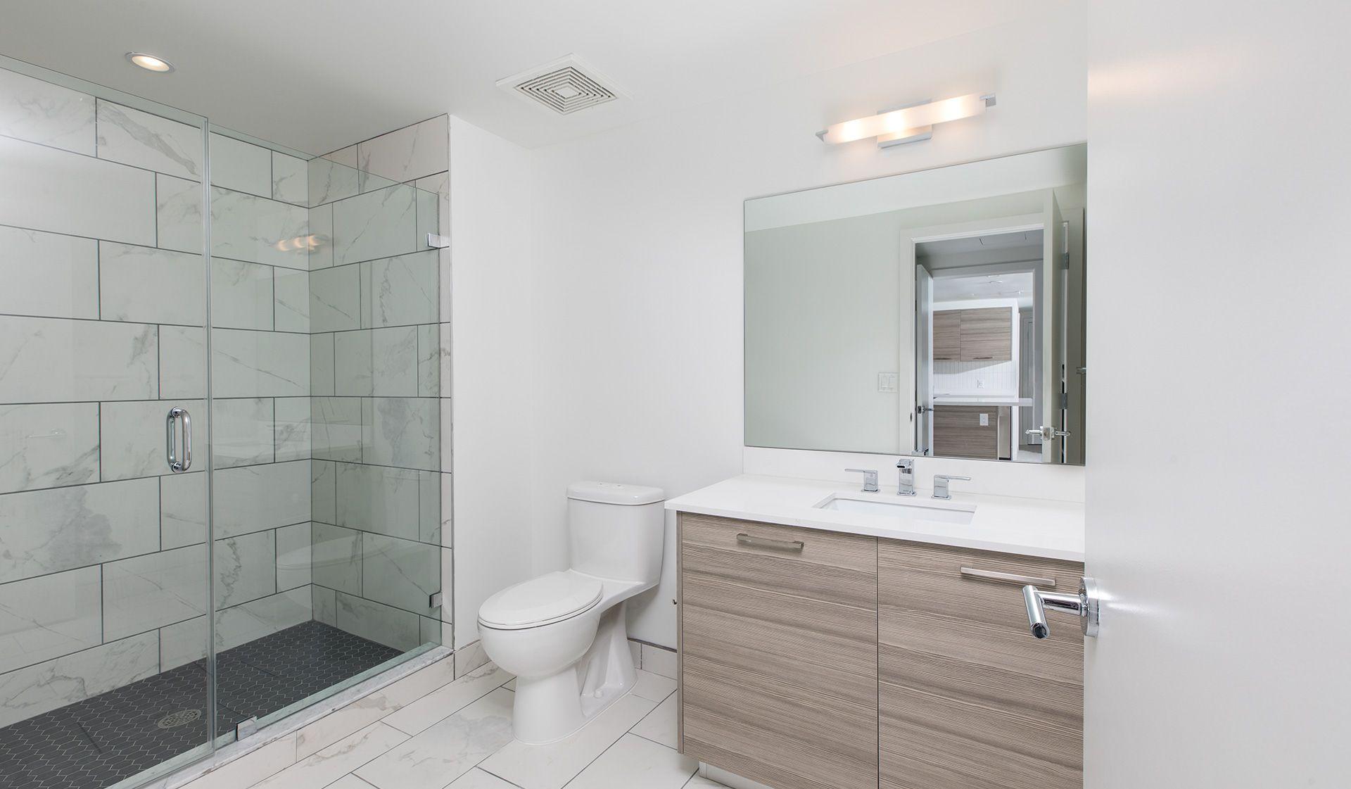 Premium bathrooms feature quartz countertops, porcelain tile floor ...