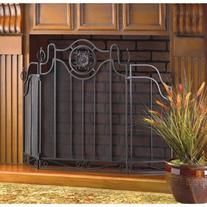 """vocative of the ironwork of traditional Italian artisans, this curvaceous folding fireplace screen features exquisite black cast iron accents. 44 1/2"""" x 1"""" x 30 3/4"""" high."""