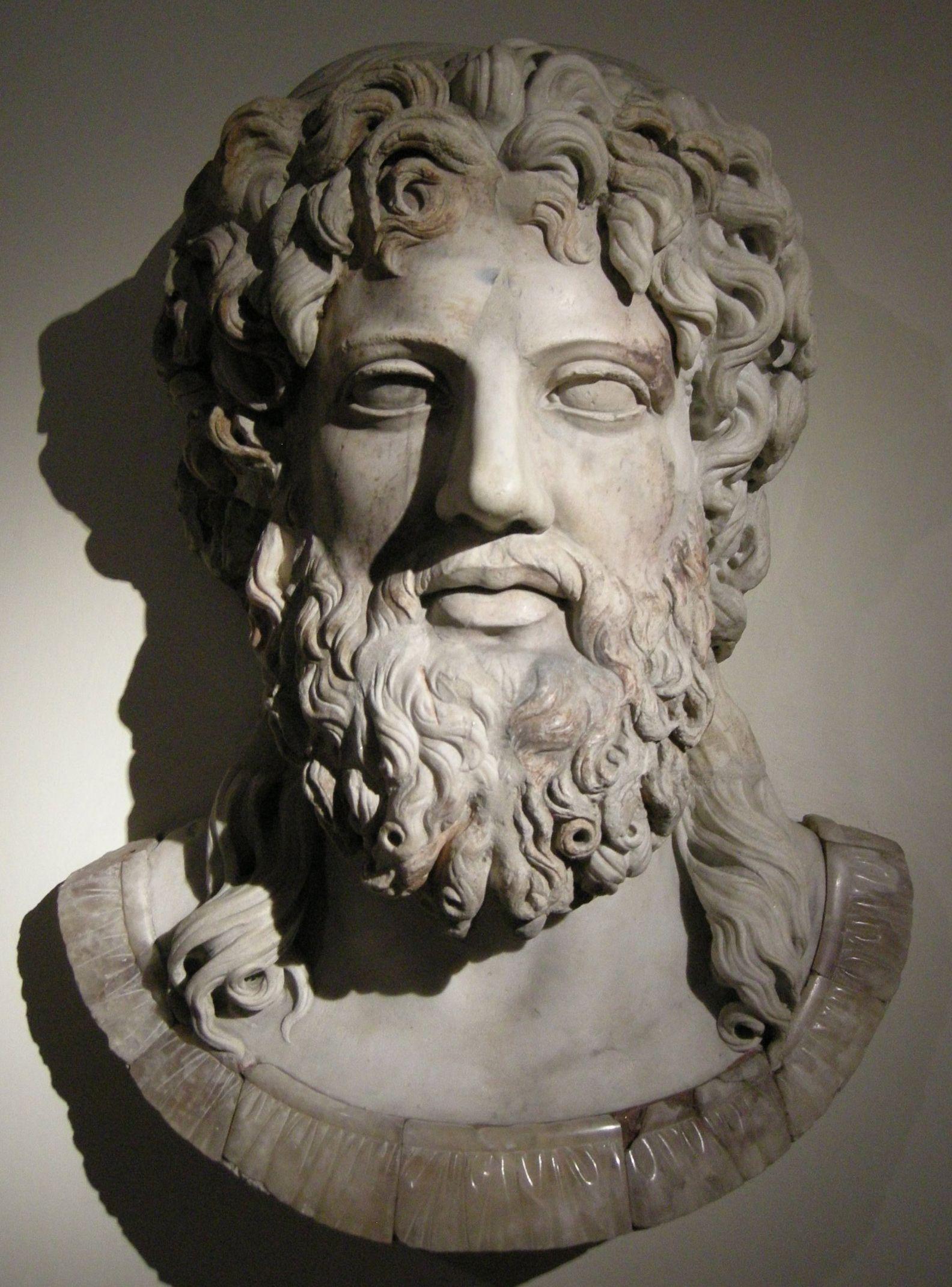 Zeus er den øverste græske gud. Han er den stærkeste, og får respekt for det. Han er en himmelgud, og hans våben er lynet. Zeus er far til et utal af græske helte, heltinder og guder: Herakles med Alkmene, Perseus med Danae, Minos, Rhadamanthys med Europe (osv). Derudover Apollon og Artemis med Leto, Hermes med Maia, Dionysos med Semele (dødelig), Athene og Ares med Hera. Med sine søskende og børn udkæmper han det sidste opgør blandt guder. Zeus sejrer, og verdensordenen sikres.