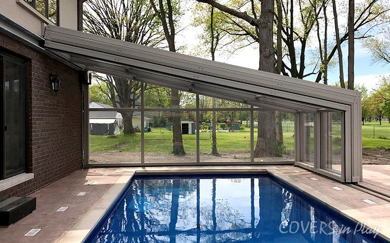 Retractable Pool Enclosures Photo Gallery Made In Canada Indoor Outdoor Pool Indoor Pool Design Pool Enclosures