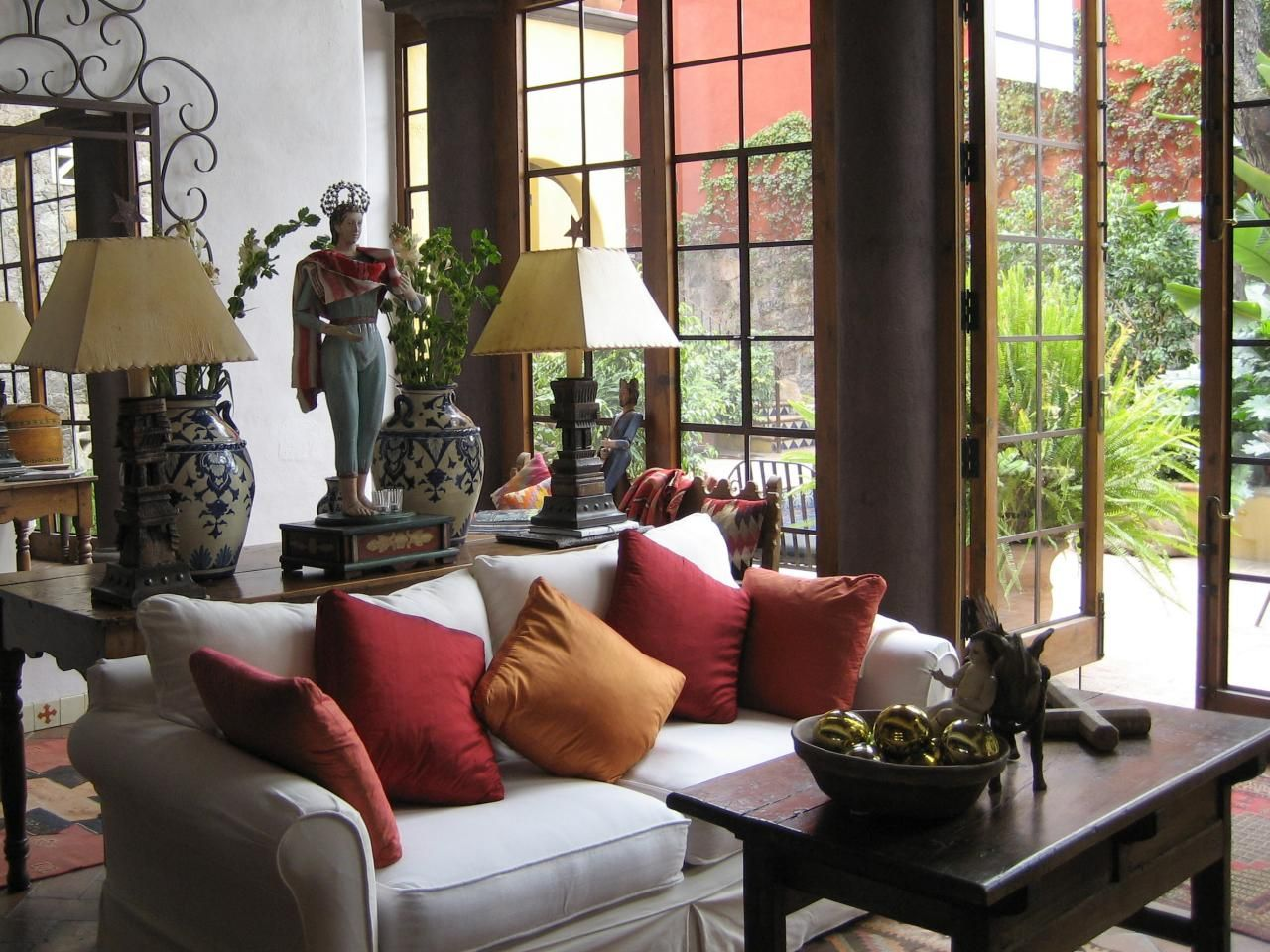 With French Doors, The Great Room In This Mexican Home Was Already Off To A  Good Start, But The Vibrant Splashes Of Color, Matching Lamps And Oversized  Iron ...
