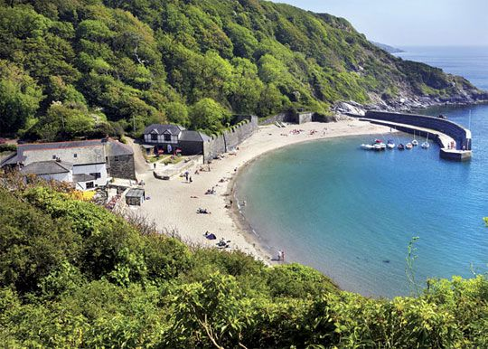 Polkerris Beach near Penhale Camping & Caravan Park, Cornwell. A sheltered, west-facing, sandy cove with excellent facilities, it is situated in a tiny hamlet overlooking St Austell Bay.