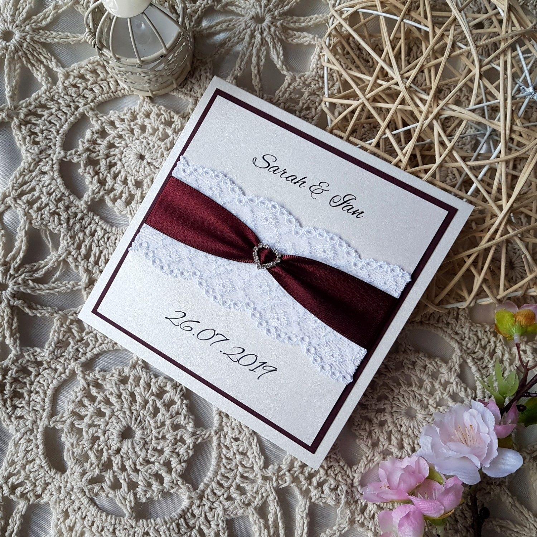 Lace and ribbon burgundy pocketfold wedding invitation in