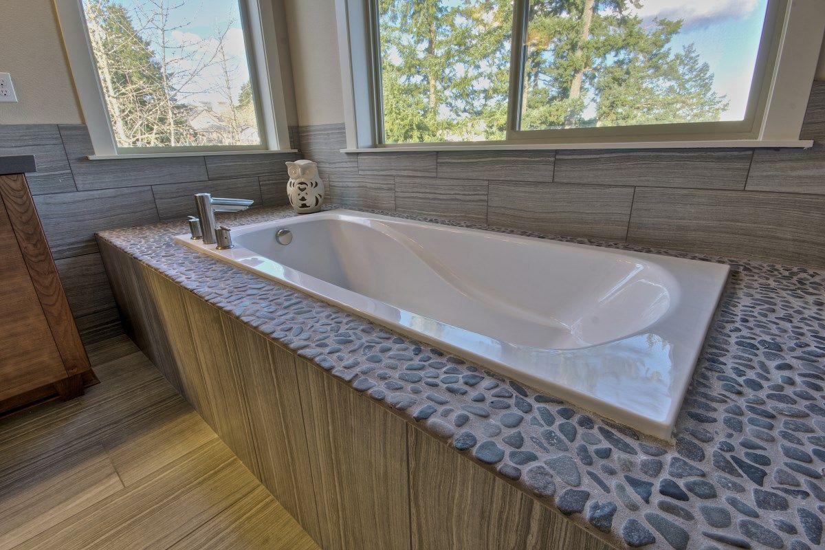 rock pebble surround with garden tub bathroom designs. Black Bedroom Furniture Sets. Home Design Ideas