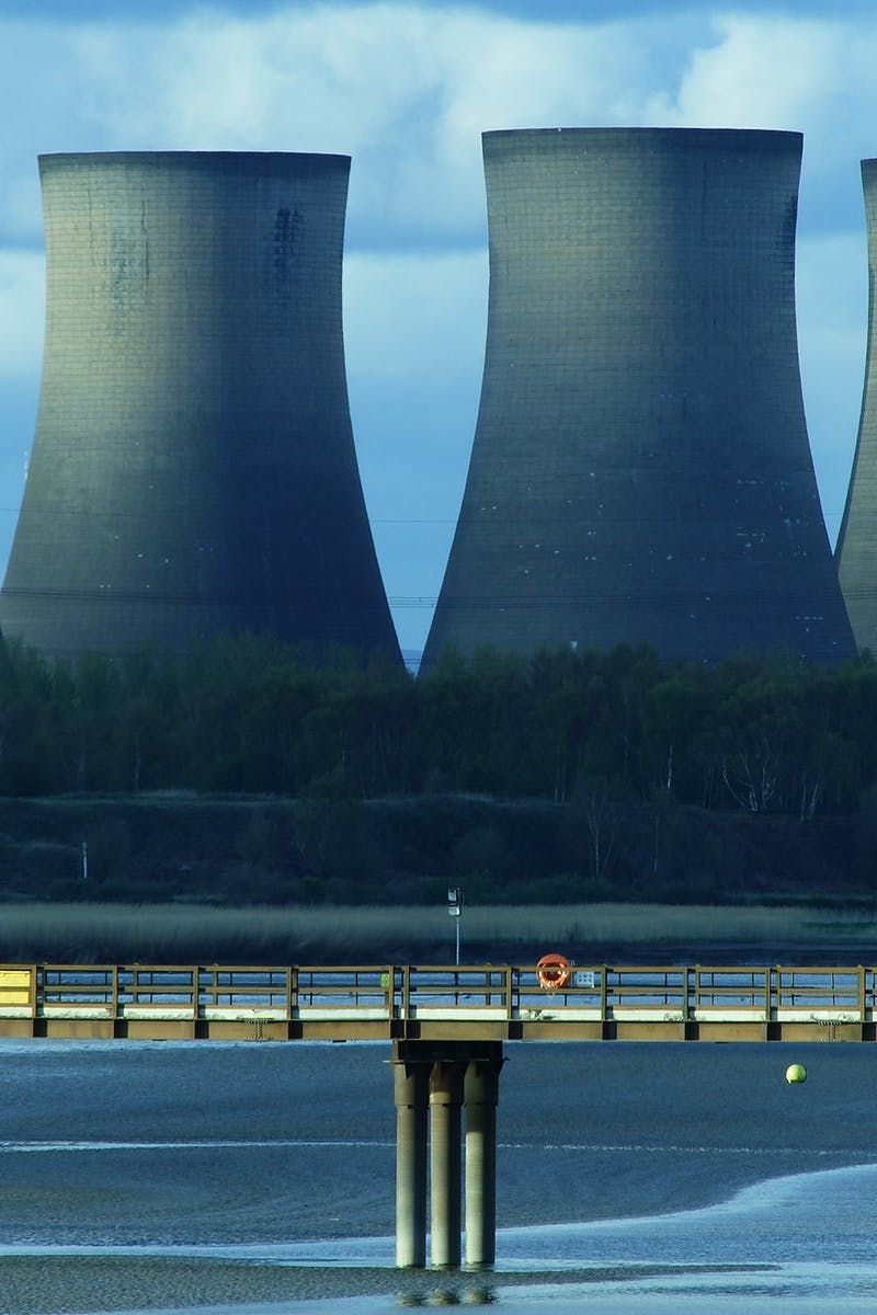 Free download of this photo: https://www.pexels.com/photo/landscape-photography-of-cooling-tower-162646/ #sea #water #bridge