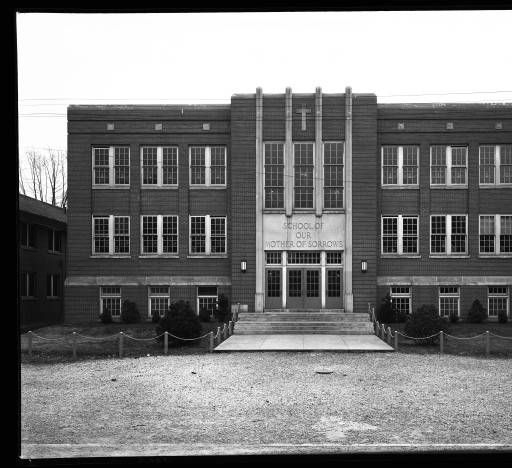 School of Our Mother of Sorrows, Louisville, Kentucky, 1939. :: Royal Photo Company CollectionSchool building for School of Our Mother of Sorrows. Three-story brick building with steps leading to the front entrance. Address: 770 Eastern Parkway, Louisville, Kentucky