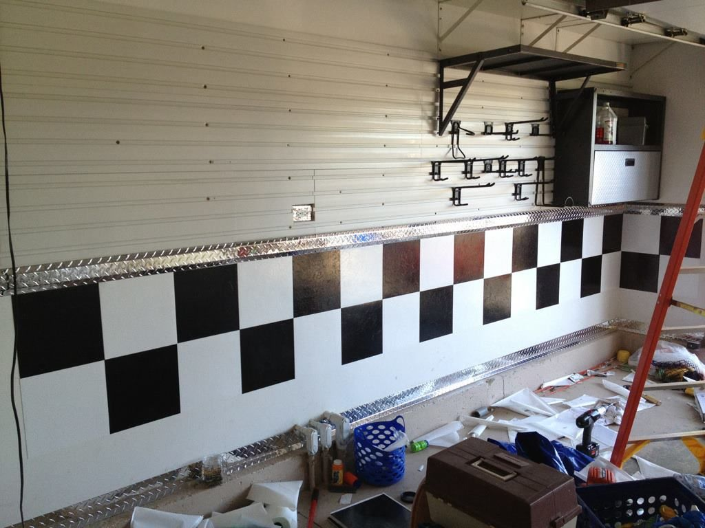 Used black and white floor tile on the garage wall to create a check used black and white floor tile on the garage wall to create a check board pattern dailygadgetfo Image collections