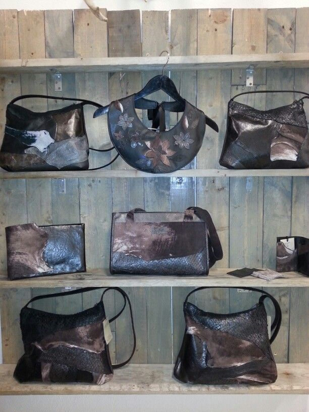 Brown and beautiful. Handbags from Arfleifð- heritage from Icaland. Fish leather and reindeer-, sheep- and seal skin.