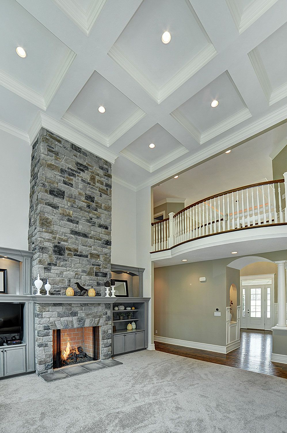 Two story family room with coffered ceiling google for Great room wall ideas