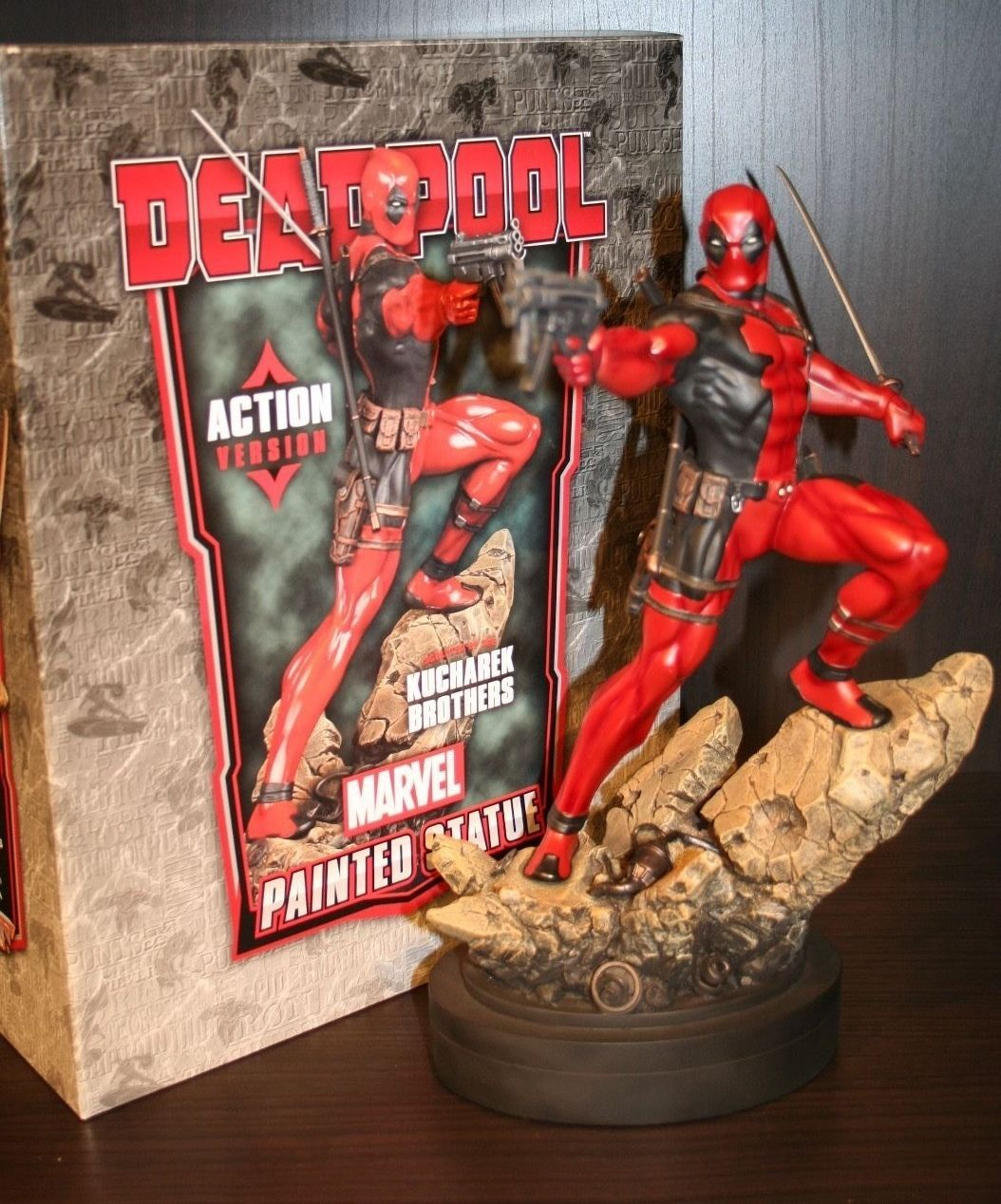 Deadpool Action statue. Designed and Sculpted by the Kucharek Brothers.