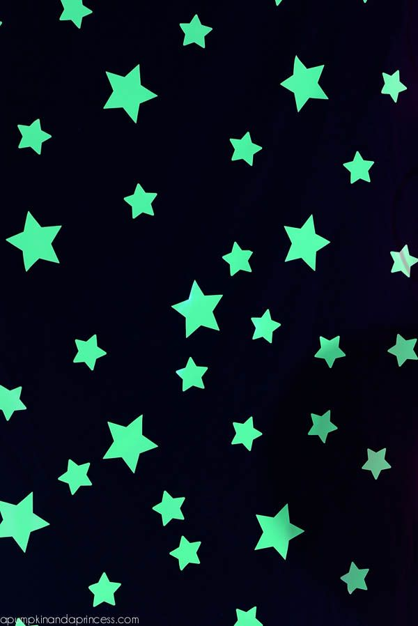 glow-in-the-dark vinyl and a star craft punch to create a starry background. The stars were placed on black tablecloths that I found on Amazon.