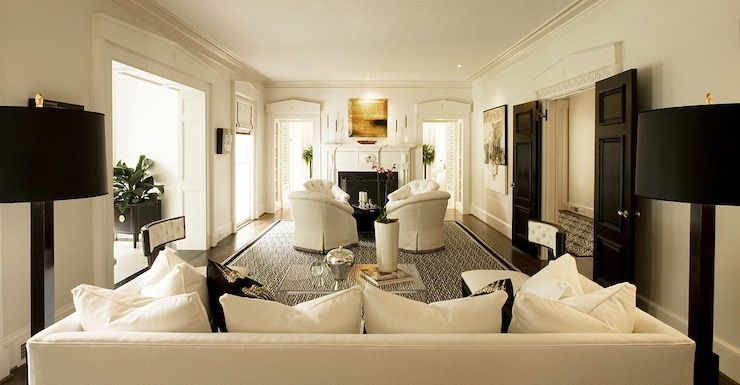 Long Living Room Features Two Separate And Distinct Living Spaces Black And White Living Room Long Living Room Long Narrow Living Room Long Living Room Design