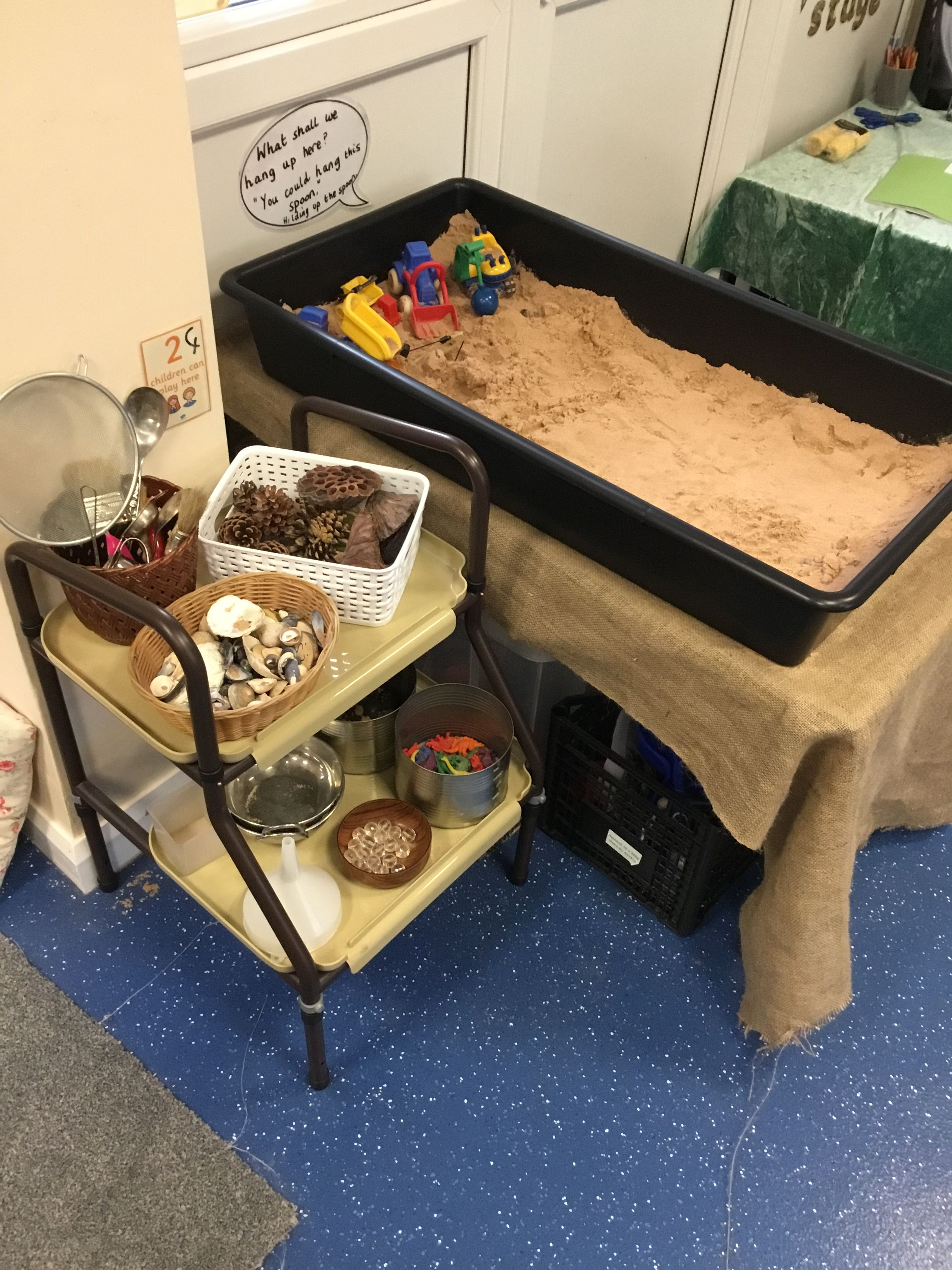 Sand area in Reception. Only have a small space but this is working pretty well. Curiosity approach style with real objects and up cycled shelving. #curiosityapproacheyfs