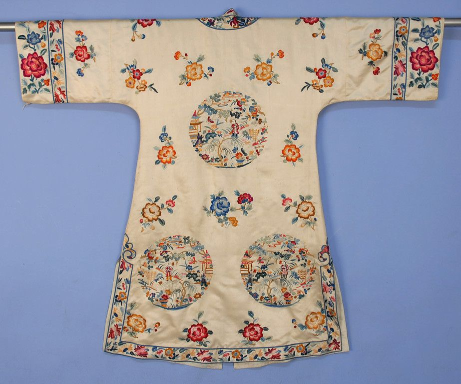 China silk embroidered robe, cream satin with vibrant satin stitch floral and figural rounds, figured silk lining and brass buttons, 20th c, back